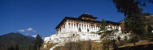 An Ancient Buddhist Monastery Perched on a Hillside Overlooking a Himalaya Valley by Jason Edwards