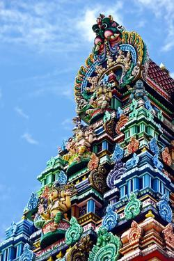 Brightly Colored Ornate Statues and Pillars at a Hindu Temple by Jason Edwards