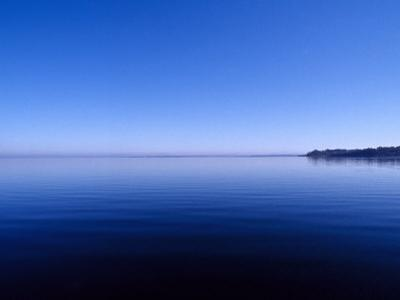Clear Blue Sky Reflected in a Still Lake Surface, Metung, Gippsland Lakes, Victoria, Australia by Jason Edwards