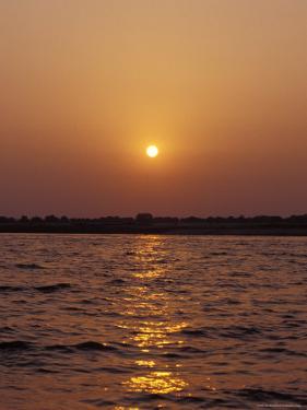 Indian Sunrise over the Holy Ganges River the Ganga at Varanassi by Jason Edwards