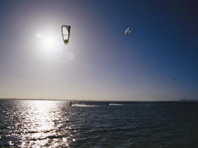 Kite Surfers Enjoying a Day on a Windswept Bay by Jason Edwards