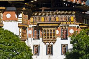 Ornately Carved and Painted Window Frames and Balconies on an Ancient Buddhist Monastery Facade by Jason Edwards