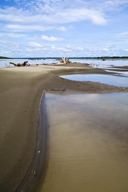 Pools of Stagnant Water Along the Shoreline of the Amazon River During the Dry Season Drought by Jason Edwards