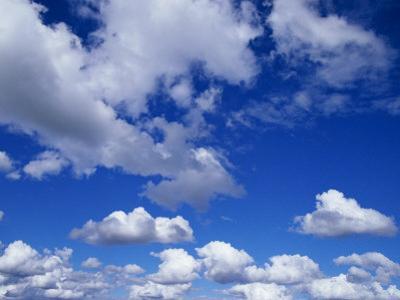 Sunlit Fluffy White Clouds in a Blue Sky