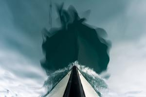 The Bow of a Boat Passing over the Still Waters of an Arctic Fjord by Jason Edwards