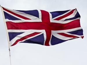 The British Union Jack Flag Flaps Proudly in a Stiff Wind by Jason Edwards