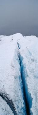 The Frozen and Barren Wasteland of Folded Ice and Crevasse on Surface of the Greenland Ice Sheet by Jason Edwards