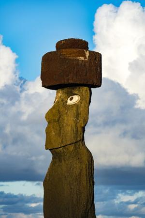 The Human Figure of a Moai Statue Wearing a Topknot Greets the Dawn a Tropical Island