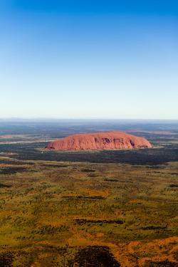 The Ochre Sandstone Dome of Uluru Rises from a Vast Desert Plain in Australia's Outback by Jason Edwards