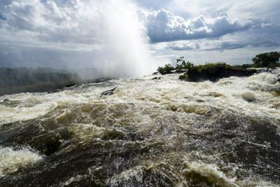 The Rapids of the Zambezi River Tumble over Victoria Falls Sending Up a Plume of Mist by Jason Edwards