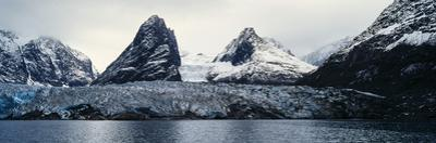The Sheer Fracture Zone of a Glacier Sandwiched Between Alpine Peaks in a Fjord by Jason Edwards
