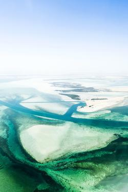 Turquoise Tidal Flats and Coastal Sea Channels Surrounded by Arid Desert Sands by Jason Edwards