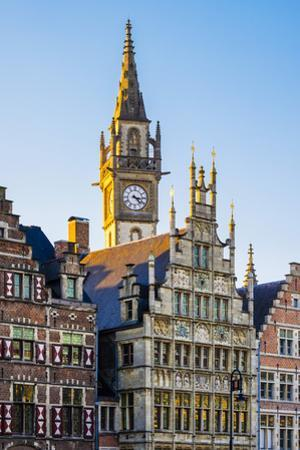 Belgium, Flanders, Ghent (Gent). Old Post Office clocktower and medieval guild houses on Graslei. by Jason Langley