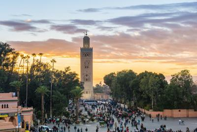 Minaret of the Koutoubia Mosque at sunset, from Jmaa El-Fna square, Marrakesh, Morocco, North Afric by Jason Langley