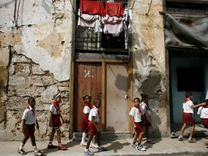 Cuban Students Walk Along a Street in Old Havana, Cuba, Monday, October 9, 2006 by Javier Galeano