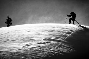 A Young Male Skier Clicks into His Bindings in the Backcountry Near Mt Baker Ski Area in Washington by Jay Goodrich