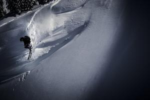 A Young Male Skier Drops into the Mount Baker Backcountry in Washington by Jay Goodrich