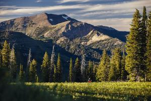 Andrew Whiteford Rides The Single Track Of Black's Canyon Teton Pass At Sunset Near Wilson, Wyoming by Jay Goodrich