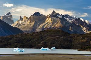 Hiker And Icebergs In Lago Grey In The Torres Del Paine National Park, Patagonia, Chile by Jay Goodrich