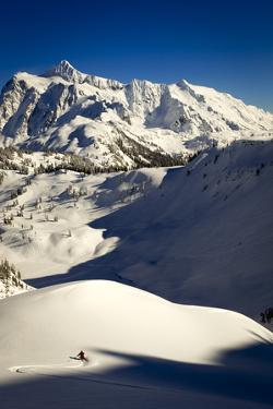 Skier Drops Into Mazama Bowl In Late Afternoon Light With Mount Shuksan In The Distance by Jay Goodrich