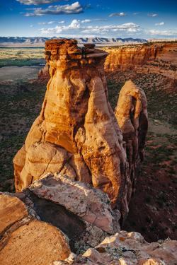 Sunset Over The Rock Formations In Colorado National Monument Near Grand Junction, Colorado by Jay Goodrich