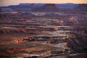 The Canyon Edges Of The Whiterim Trail At Sunset In Canyonlands National Park Near Moab, Utah by Jay Goodrich