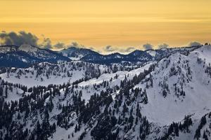 The Peaks Of The Cascades Layer A Clearing Sky In Late Afternoon Light by Jay Goodrich