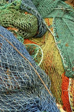 Europe, Scotland, Oban, brightly colored fishing nets by Jay Sturdevant