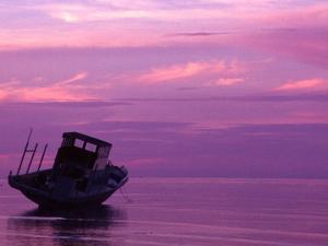 Fishing Boat at Sunset, Bunaken, Sulawesi, Indonesia by Jay Sturdevant