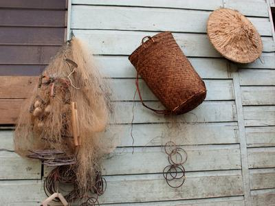 Hat, Basket, and Fishing Net Hanging Outside Iban Longhouse, Sarawak, Borneo, Malaysia