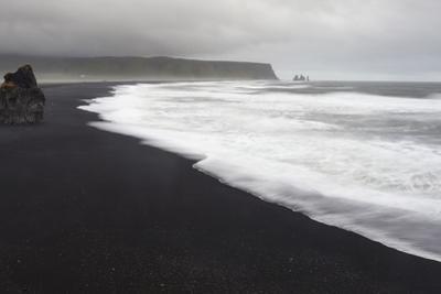 Basalt Column Rises from Black Sand Beach on Rainy Day, Vik, Iceland by Jaynes Gallery