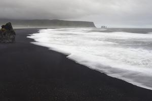 Basalt Column Rises from Black Sand Beach on Rainy Day, Vik, Iceland by Jaynes Gallery