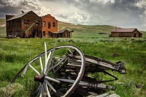 California, Bodie State Historic Park. Broken Wagon and Abandoned Buildings by Jaynes Gallery