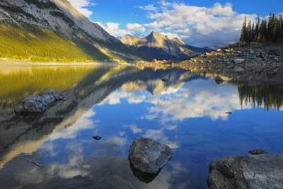 Canada, Alberta, Jasper National Park. Colin Range reflection in Medicine Lake at sunset. by Jaynes Gallery