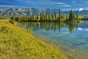 Canada, Alberta, Jasper National Park. Mountains and trees reflection in Talbot Lake. by Jaynes Gallery