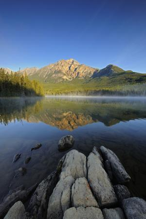 Canada, Alberta, Jasper National Park. Sunrise on Pyramid Mountain and Lake. by Jaynes Gallery