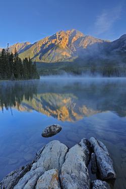 Canada, Alberta, Jasper National Park. Sunrise on Pyramid Mountain and Lake. by Jaynes Gallery