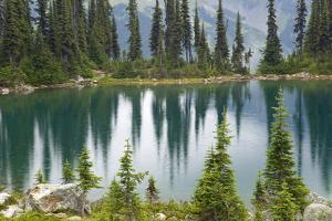Canada, British Columbia, Revelstoke National Park. Rain dots Lake Eva. by Jaynes Gallery