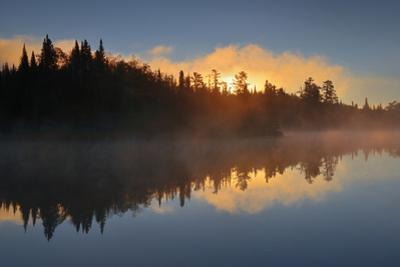 Canada, Manitoba, Whiteshell Provincial Park. Fog at dawn on Lyons Lake. by Jaynes Gallery