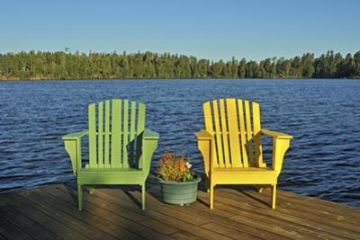 Canada, Manitoba, Whiteshell Provincial Park. Muskoka chairs on Star Lake dock. by Jaynes Gallery