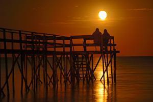 Canada, Manitoba, Winnipeg. Couple watching moonrise on Lake Winnipeg. by Jaynes Gallery