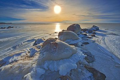 Canada, Manitoba, Winnipeg. Sunset on Lake Winnipeg spring ice. by Jaynes Gallery