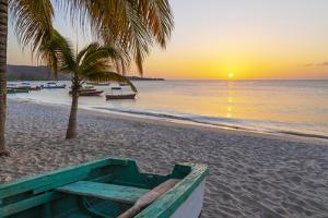 Caribbean, Grenada, Grenadines. Sunset and wooden fishing boat on Grand Anse Beach. by Jaynes Gallery