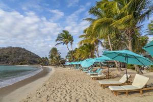 Caribbean, Grenada, Mayreau Island. Beach umbrellas and lounge chairs. by Jaynes Gallery
