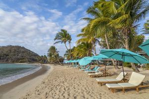 Caribbean, Grenada, Mayreau Island. Beach umbrellas and lounge chairs. by Jaynes Gallery