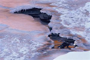 Colorado, Lyons. Ice and Snow Pattern in Saint Vrain River at Sunset by Jaynes Gallery