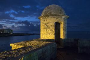 Cuba, Havana. Golden light illumines stone turret of old fort. by Jaynes Gallery