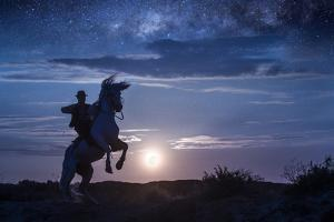 Europe, France, Provence, Camargue. Composite of man on rearing Camargue horse at sunrise. by Jaynes Gallery