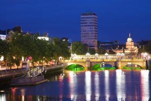 Europe, Ireland, Dublin. Ha Penny Bridge and River Liffey lit at night. by Jaynes Gallery