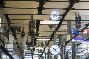 Europe, Netherlands, Amsterdam. Commuters reflected in ceiling of central train station. by Jaynes Gallery